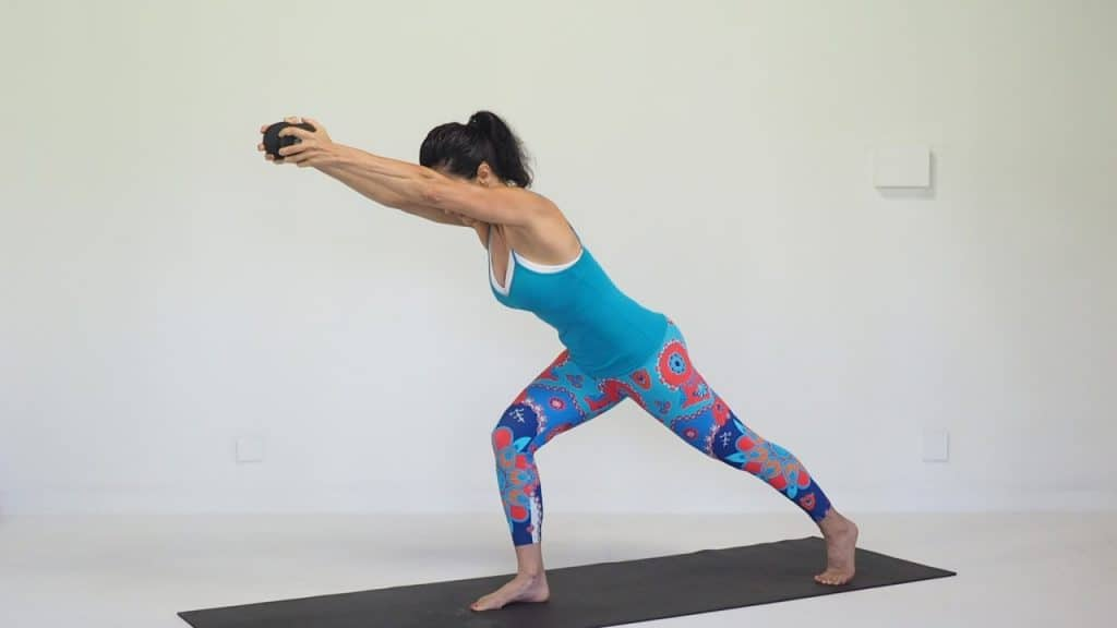 warrior pose with dumbell for core strength during menopause