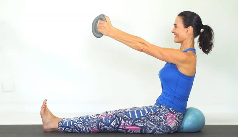 Get rid of flabby arms with DB Pilates ball abs combo
