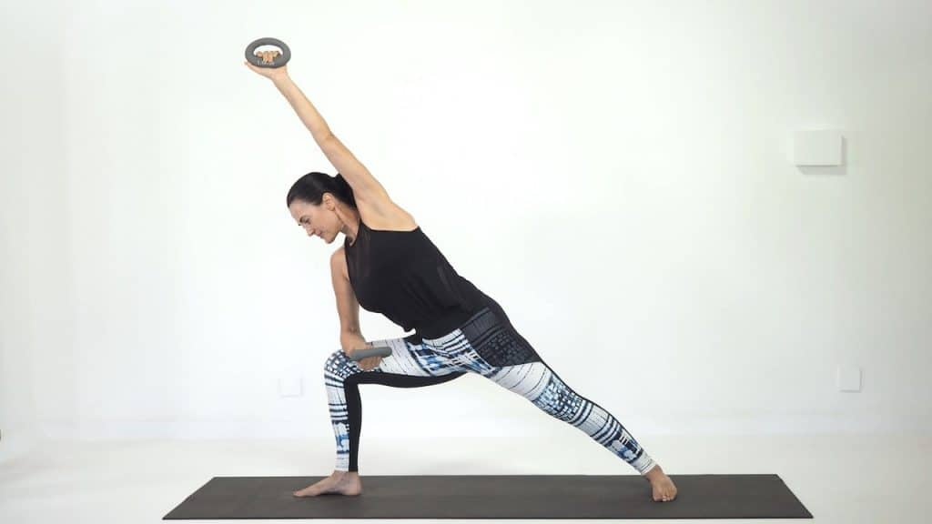 Power yoga side angle pose with DB's