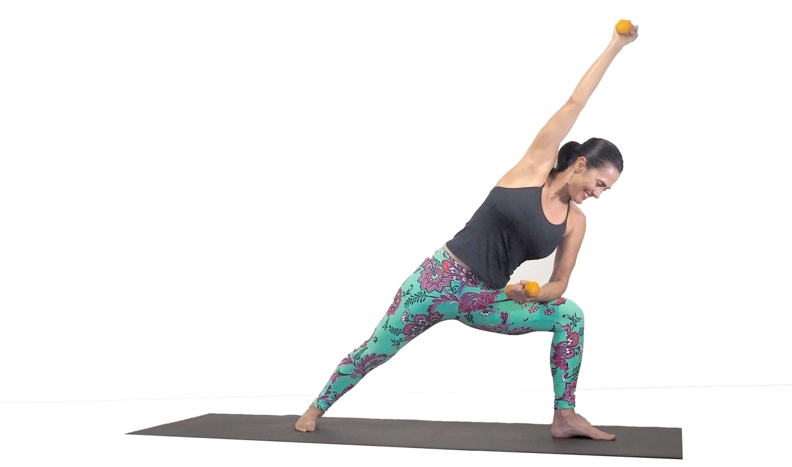 Yoga with weights - side angle pose using dumbbells
